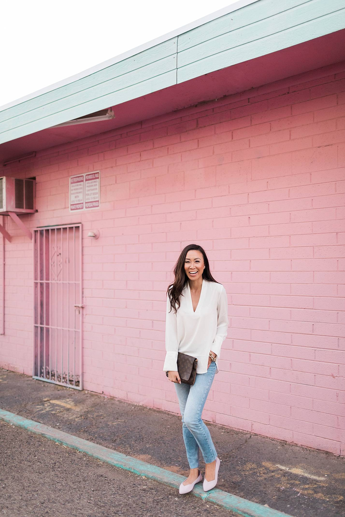 pink flats by rothy's pink wall
