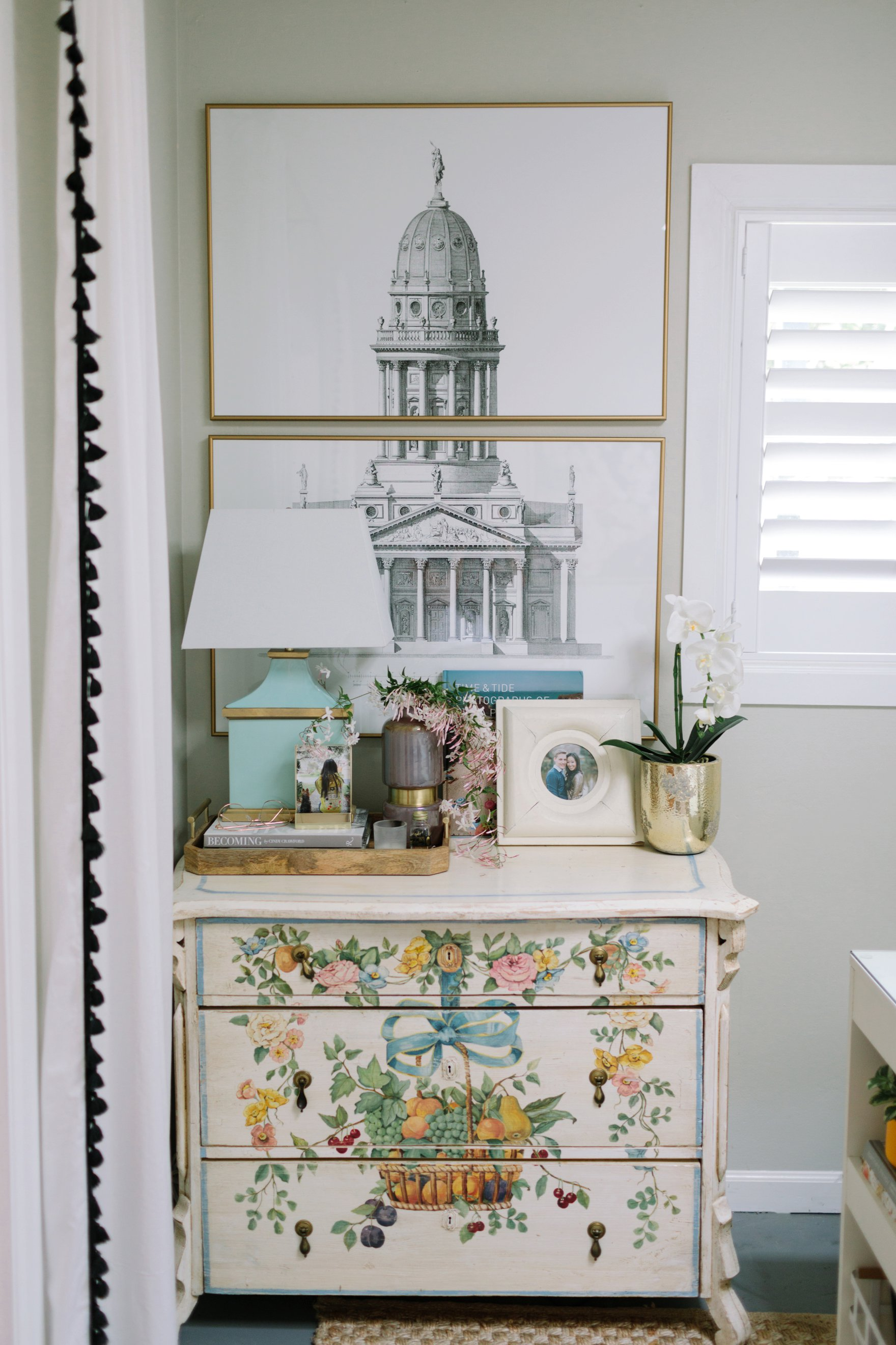 Antique English dresser featuring stacked sketch of architectural prints - blogger photographer home office