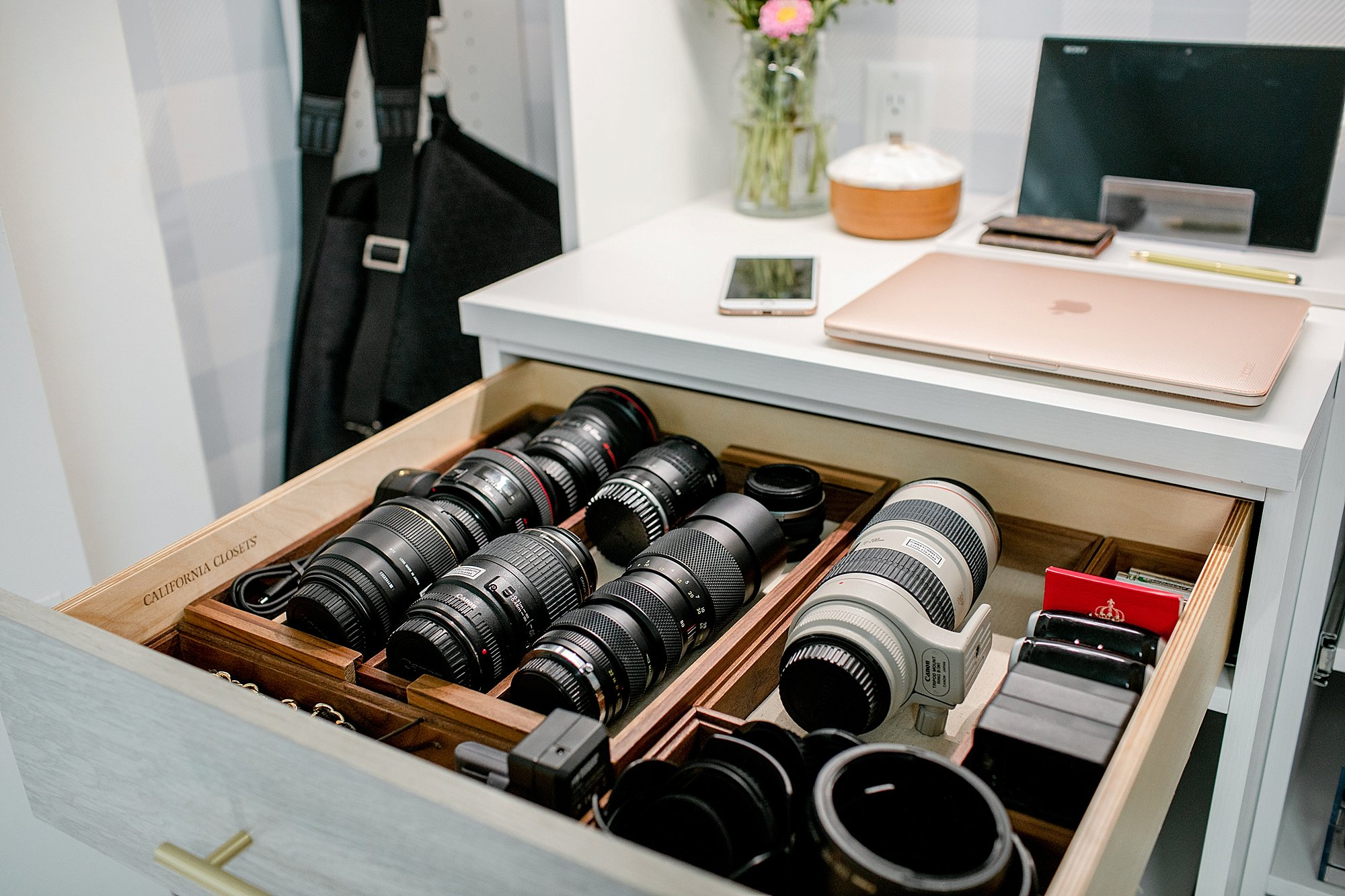 lens organization and camera lens drawer: final reveal of office closet reveal belonging to photographer blogger Diana Elizabeth in phoenix arizona. created by California closets and with removable buffalo check wallpaper #office #closet #wallpaper #organization #lensorganization #lensdrawer
