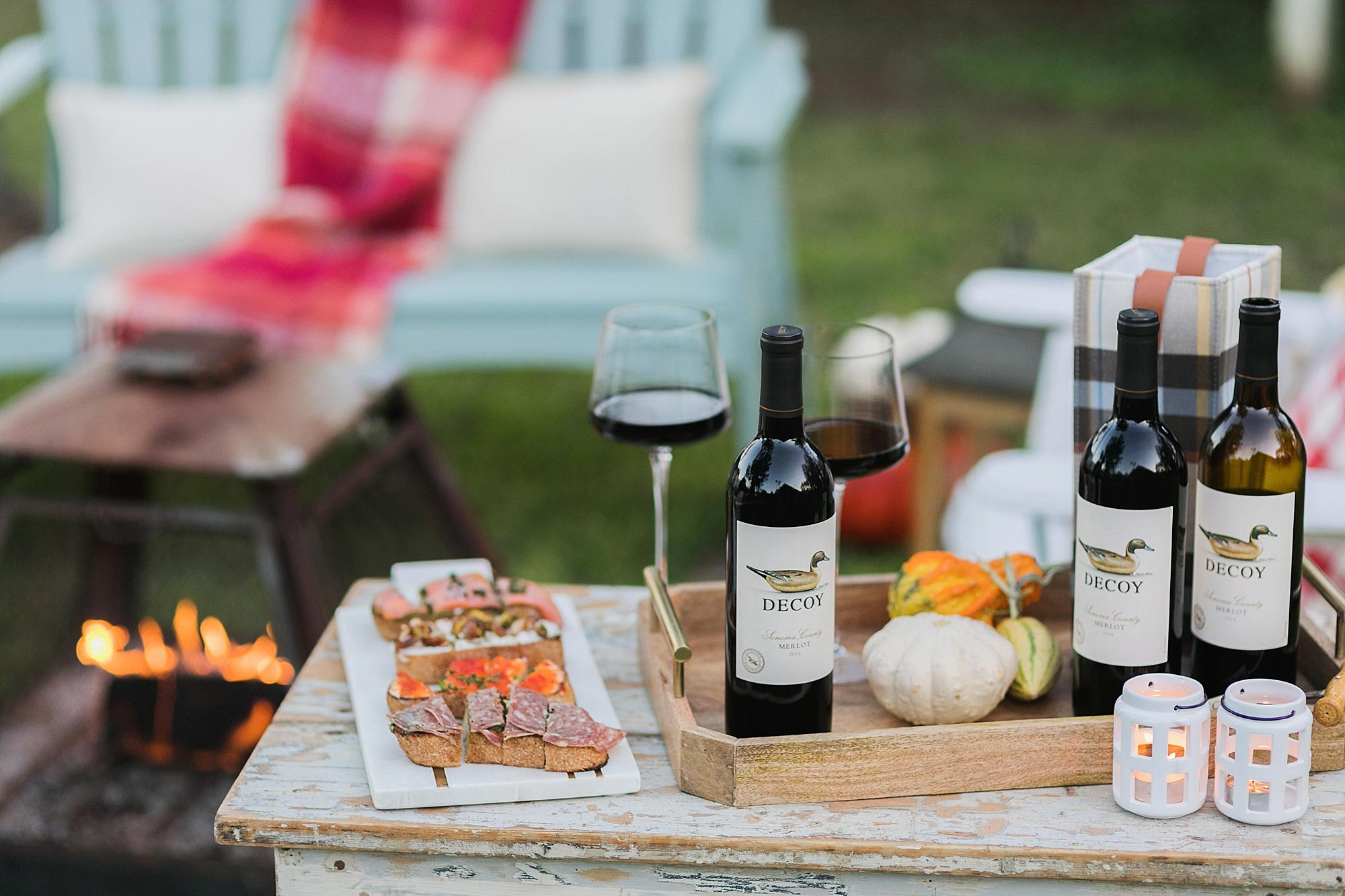 merlot decoy wine for merlot month in October. fire pit for fall gathering outdoors and bruschetta board for wine