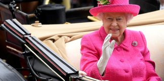 The Queen's hat featured a pretty tulip adornment and she teamed the ensemble with her trusty white gloves