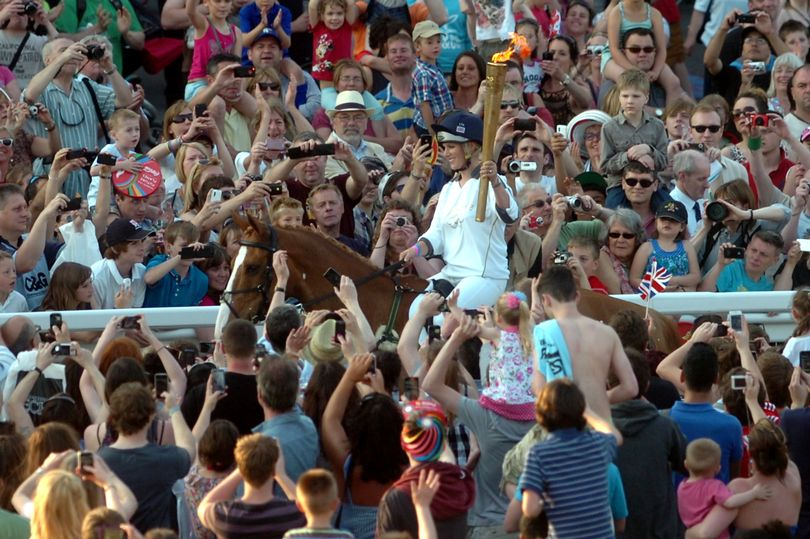 Zara Phillips on Toytown delivering the Olympic torch at Cheltenham Racecourse in 2012 Photo (C) GETTY IMAGES