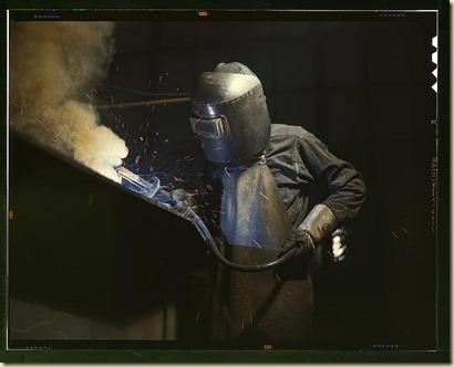 man in welding mask