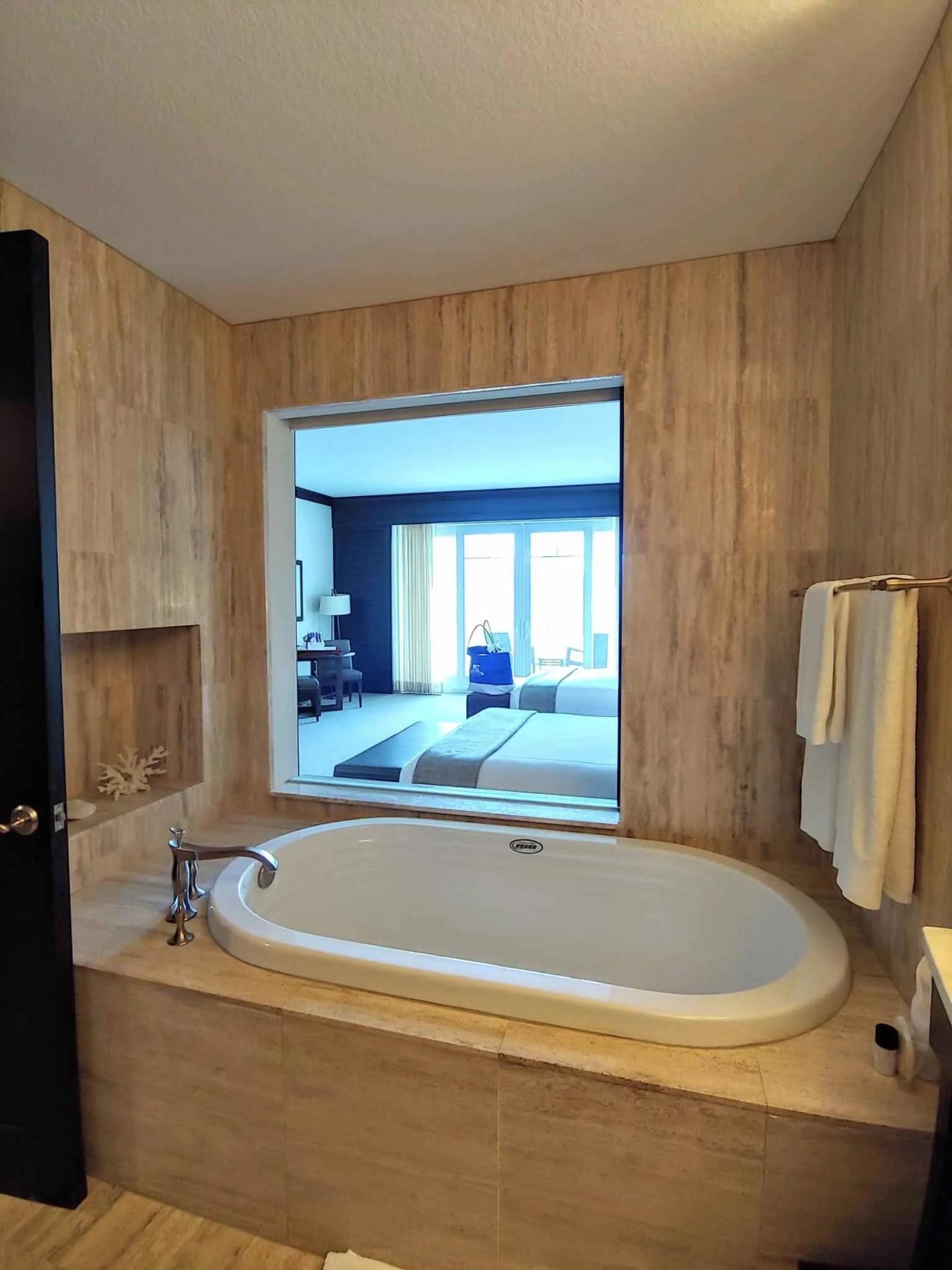 soaker tub overlooking bedroom