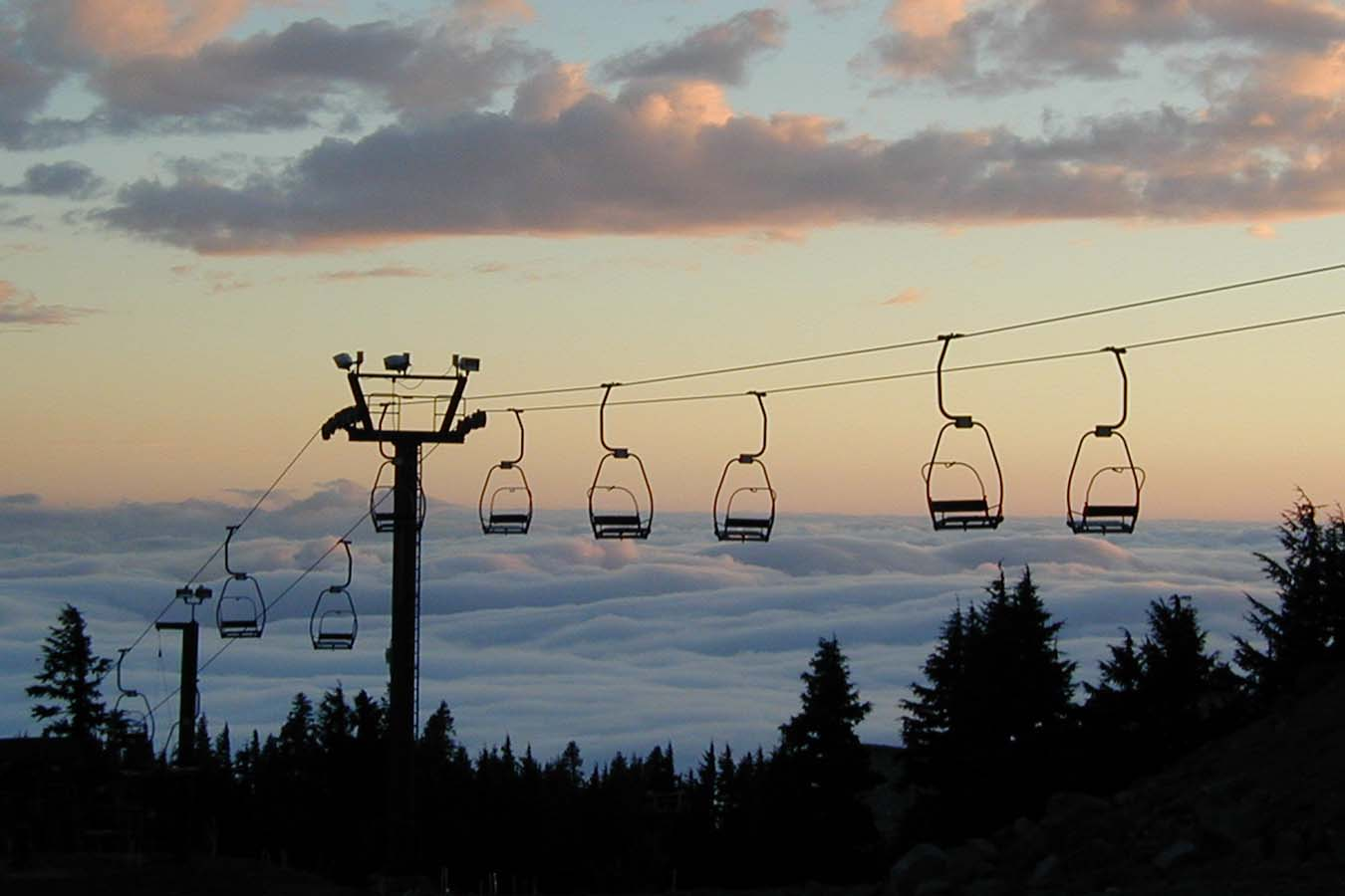 Chairlifts Rise Above Clouds