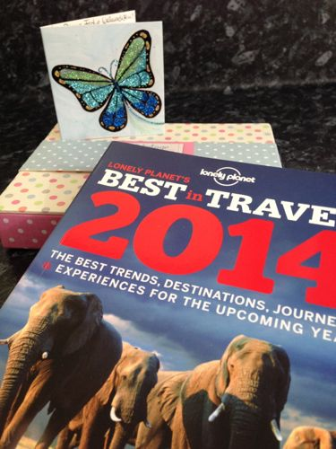 My Twitter Secret Santa gift: awesome post-its and the Lonely Planet Best in Travel 2014.