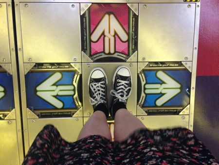 Diane's feet on the floor plate for the Dance-Dance-Revolution game.