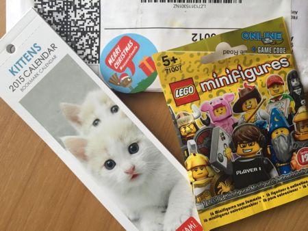 Jennifers presents: a kitten bookmark calendar and a lego mini figure.
