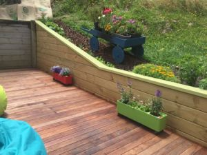 The deck with beanbags and planters with the new retaining wall in the background.