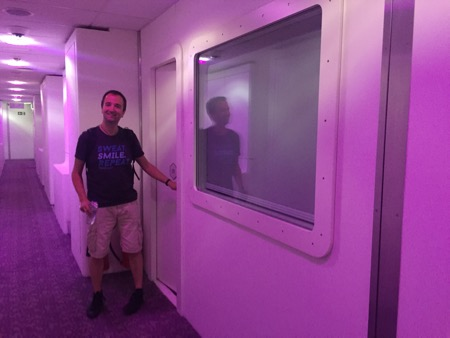 Kai in front of our Yotel capsule room.
