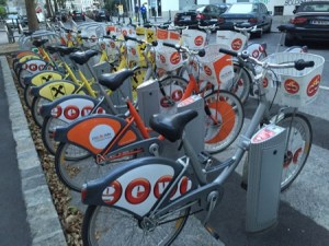 Lots of bicycles in a rental station.
