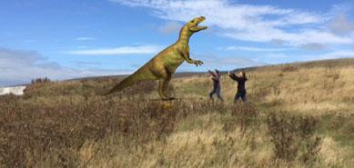 Fighting a virtual dinosaur.