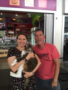 Diane holding Didga the cat, with Didga's owner Robert standing to their right.