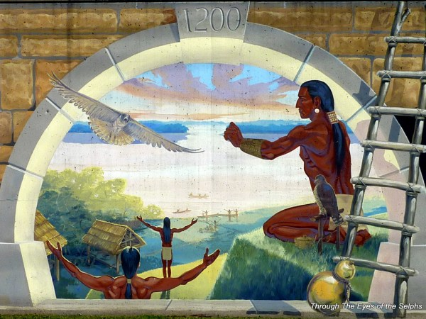 Between 900 and 1200 AD many Native Americans lived in the Mississippi Valley.  They lived in harmony with nature and trained red tailed hawks to hunt.  In this mural they greet the morning sun as it rises over the great river.