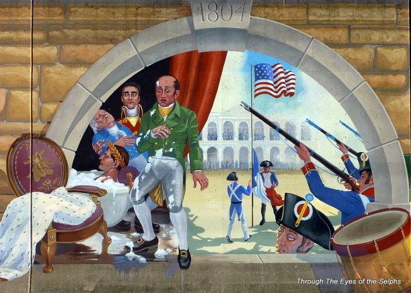 The Louisiana Purchase.  Napoleon renounces Louisiana in his bath, causing his servant to faint into the arms of his brother.  At 1803 in New Orleans the French colors were lowered and the U.S. flag was raised.  A French soldier sheds a tear.  In March, 1804, Upper Louisiana was formally transferred to the United States at St. Louis.
