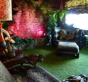 The Jungle Room with a waterfall on the wall