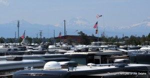 Looking west over the sea of motorhomes with the three sister mountains