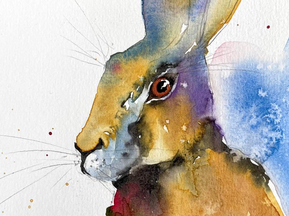 Closeup of watercolor Hare showing details of painting the face and using salt for texture in the background