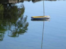 tiny_sailboat_water_reflection