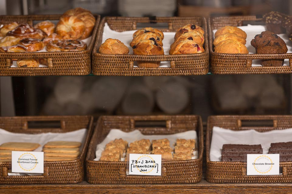 pastry case with assorted muffins