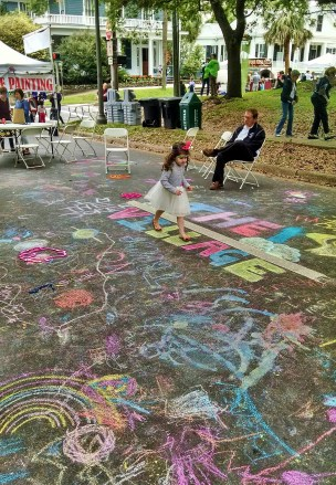 Little Girl Playing in Chalk