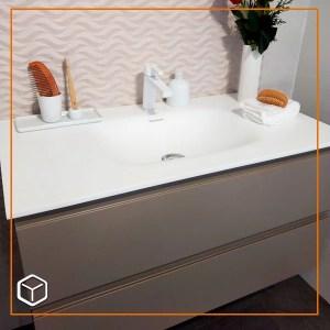 Mueble lavamanos con superficie en resina acrílica y mueble empotrado enchapado en fórmica