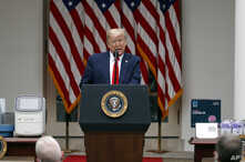 President Donald Trump speaks about the coronavirus during a press briefing in the Rose Garden of the White House, Monday, May…