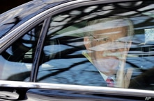 Former National security adviser John Bolton waves as he leaves his home in Bethesda, Md. Tuesday, Jan. 28, 2020. President…