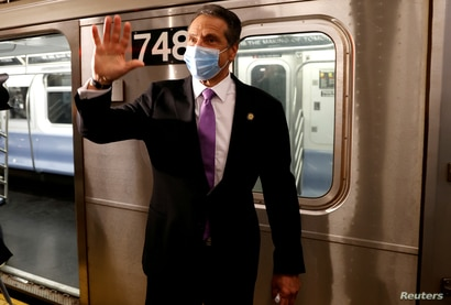 New York Governor Andrew Cuomo exits a #7 Subway train in Manhattan on the first day of New York City's phase one reopening…