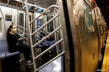 Morning commuters ride a Metropolitan Transportation Authority (MTA) subway, as phase one of reopening after lockdown begins,…