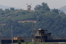 A North Korean soldier stands guard at his guard post inside North Korean territory, in this picture taken from Paju, South…
