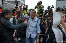 Jimmy Lai, dueño del Apple Daily News, vocea consignas antigubernamentales antes de ser arrestado por la policía de Hong Kong en diciembre de 2014. Este 28 de febrero de 2020 volvió a ser detenido.