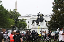 Washington Metropolitan Police officers on bicycles arrive as protestors continue to try to pull down the statue of U.S…