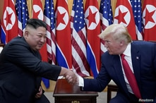 FILE PHOTO: U.S. President Donald Trump shakes hands with North Korean leader Kim Jong Un at the demilitarized zone separating…
