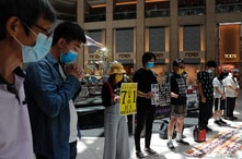 Pro-democracy protesters observe a minute of silence during a protest after China's parliament passes a national security law…