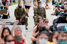 Minnesota Army National Guard Chaplains take a knee with protesters during a peaceful demonstration near the Minnesota State…