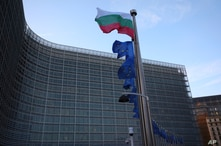 The Bulgarian and European Union flags flap in the wind outside EU headquarters in Brussels, Friday, Feb. 21, 2020. In a second…