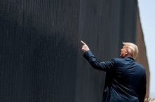 TOPSHOT - US President Donald Trump participates in a ceremony commemorating the 200th mile of border wall at the international…
