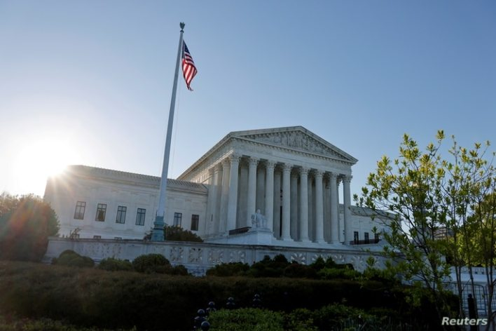FILE PHOTO: Morning rises over the U.S. Supreme Court building in Washington, U.S. April 26, 2021. REUTERS/Jonathan Ernst/File…