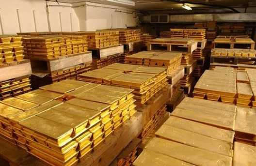 """Gold bars stored in the HSBC vaults in London are seen November 16, 2007. Twice a day, representatives of five banks pick up the phone to trade physical gold and arrive at the London """"fixing"""" price, which then becomes a benchmark for gold around the world. To match feature GOLD-FIXING/  REUTERS/World Gold Trust Services/Handout       (BRITAIN).  EDITORIAL USE ONLY. NOT FOR SALE FOR MARKETING OR ADVERTISING CAMPAIGNS. NO ARCHIVES. NO SALES."""