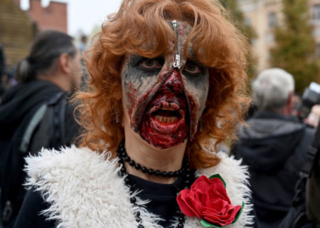 An enthusiast dressed as a zombie takes part in the traditional Zombie Parade in Kiev on October 26, 2019, to celebrate Halloween. (Photo by Sergei SUPINSKY / AFP)