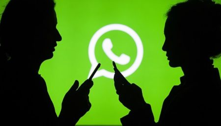 ANKARA, TURKEY - JULY 18 : Silhouettes of people holding mobile phones are seen in front of the logo of WhatsApp application in Ankara, Turkey on July 18, 2018. (Photo by Aytac Unal/Anadolu Agency/Getty Images)