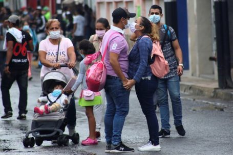 People wear face masks near the Venezuelan-Colombia border after the Colombian government decided to close the Simon Bolivar international bridge as a preventive measure in response to the spreading coronavirus disease (COVID-19) in San Antonio, Tachira, Venezuela March 14, 2020. REUTERS/Carlos Eduardo Ramirez     TPX IMAGES OF THE DAY