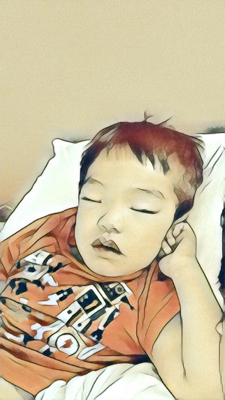 Image of Collin upclose sleeping in the day after the long 45th annversary event. He lasted the entire event even with the hundreds of people and other sensory issues. It is a photo that I used a sketch filter.