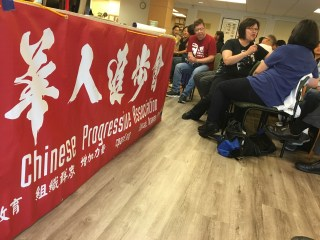 "Image of our intergenerational dialogue. There is a huge red banner of CPA on the left and on the right are a number of the ""OGs"" talking in small groups"