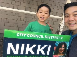Selfie of me and Collin with a campaign sign for Nikki Bas, who is a long time friend and running for city council in our district in Oakland.