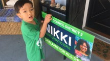 Collin doorknocking our neighbors to put up a sign.