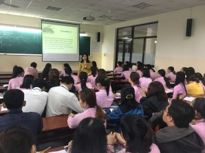 Image of Professor Vinh speaking to her students in a large classroom