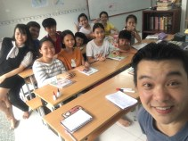 A selfie of me with a small group of 6th graders and their teachers in their classroom in Nha Be, a working class district of Ho Chi Minh City.