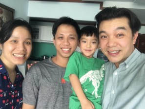 Selfie of me and Collin with Professor Vinh and her husband in their home.